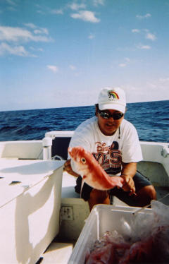 Recreational bottomfish fisherman, Richard Shiroma with prize onaga catch.